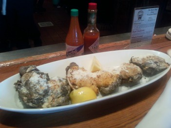 Eating stuffed oyster Rockefeller in New Orleans.